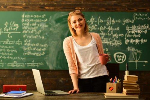 teacher standing at desk