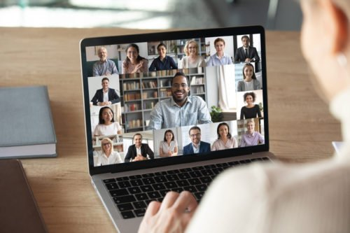 Image of laptop screen showing a video conference in process