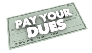 The words Pay Your Dues superimposed over a check