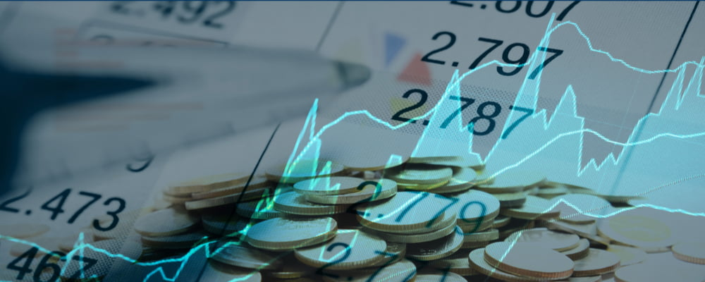 Image of stock charts and coins