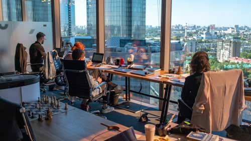 Workers at desks in high rise building
